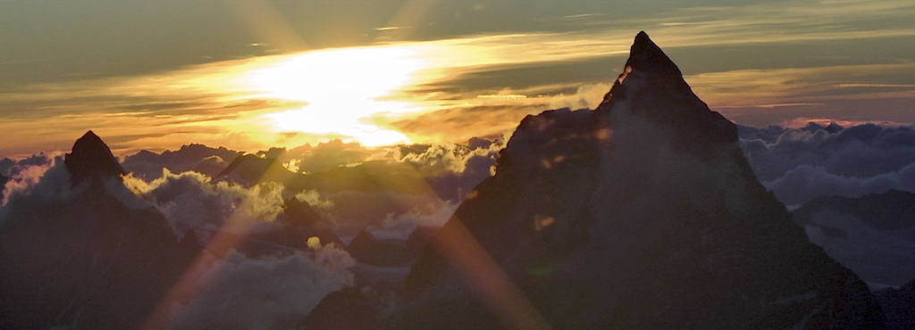 The Matterhorn at sunset from inside the Margherita Hut on the summit of Monte Rosa.